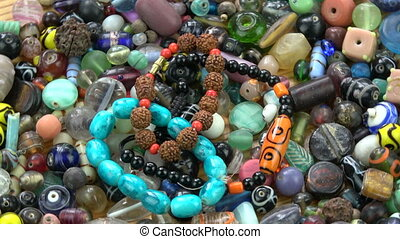 Rotating colorful various indian old and new beads bracelet background
