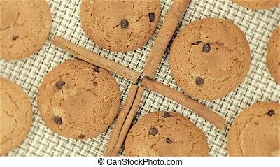 Rotating cookies and cinnamon on napkin, video