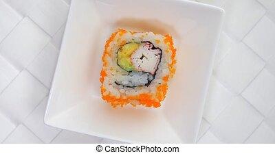 Rotating crab avocado Sushi roll on plate - Japanese crab...