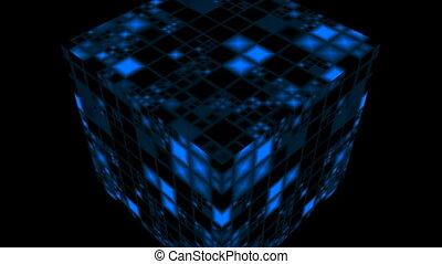 The blue shone cube rotates against a dark background