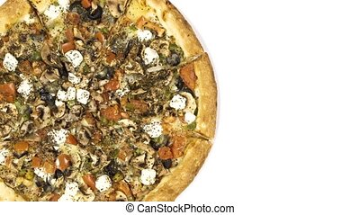 rotating delicious pizza on a white background. view from above