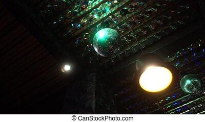Rotating disco ball in a dark room