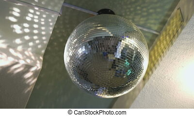 Rotating disco mirror ball