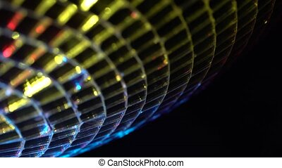 Rotating disco mirror ball. Rotating sparkling disco ball. Concept of night party. Black background. Close up