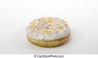 rotating donut with white icing on a white background