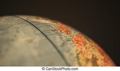 Rotating earth globe - Close up of rotating earth globe over...