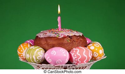 Easter cake with burning candle and