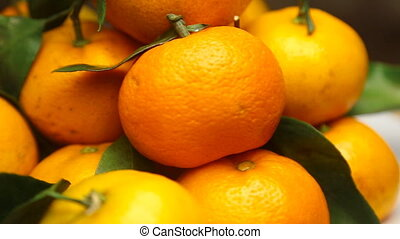 Rotating fresh Tangerines - Rotating Tangerines with fresh...