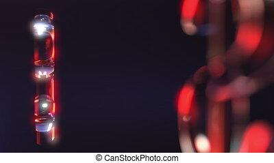 Rotating glass dollar signs against dark background