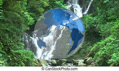 Rotating globe in front of water falls