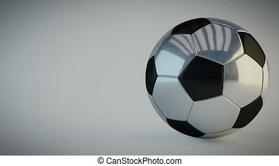Rotating glossy soccer ball on white background - seamless...