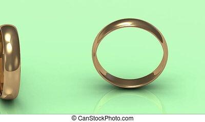 Rotating gold wedding rings