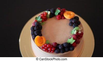 rotating homemade professional quality chocolate cake with...