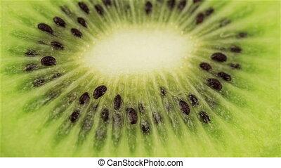 Rotating kiwi slice, macro. Fresh and healthy organic food