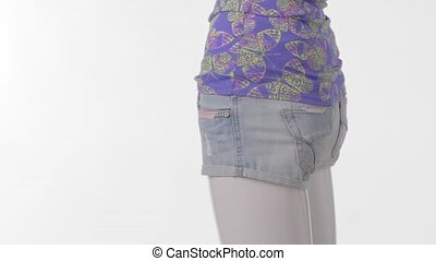 Rotating mannequin in short shorts. Light denim shorts for...