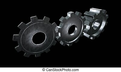 Rotating metallic gears. Black background. Alpha channel -...