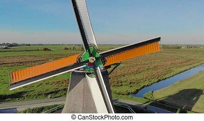 Rotating mills aerial shooting, closeup
