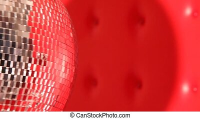 rotating mirror disco ball in left side of frame