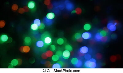 Rotating multicolored bokeh lights. Christmas and new year...