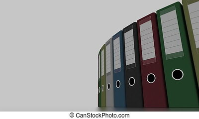 Rotating multicolored office binders for reports and presentations. 4K seamless loopable clip