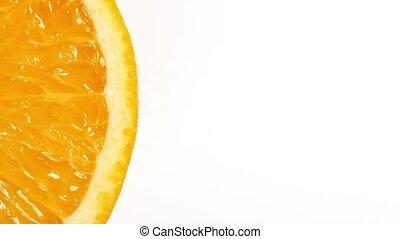 rotating orange slice (seamless loopable) isolated on white...