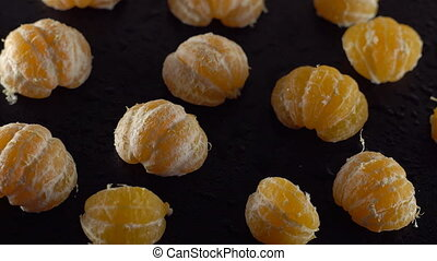 Rotating peeled tangerine slices closeup