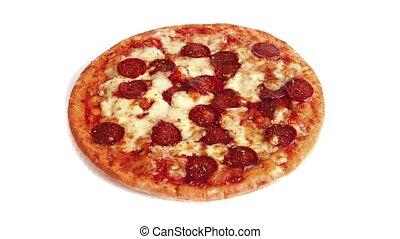 Rotating Pepperoni Pizza On Plain Background - Pizza turning...