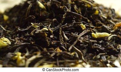 Rotating pile of jasmine green tea