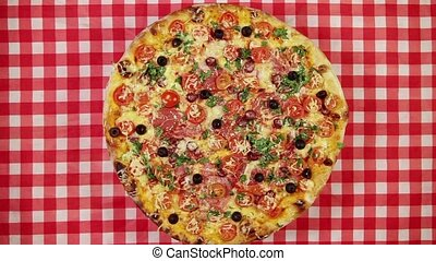 Rotating pizza on the red tableclot - Rotating pizza with...