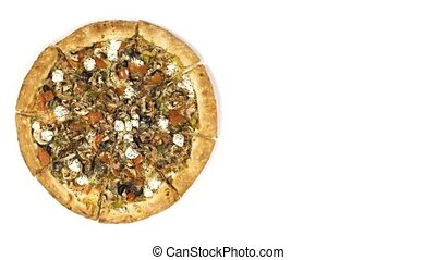 Rotating pizza with smoked sausage and olives on a white...