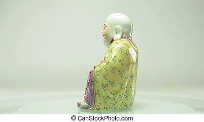 Rotating porcelain Buddha statuette - Porcelain figurine of...