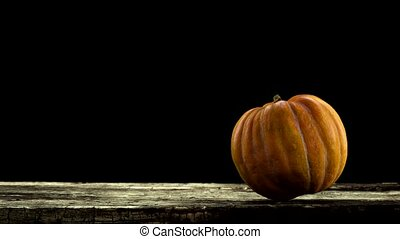 rotating pumpkin on black background with alpha channel . 3d...