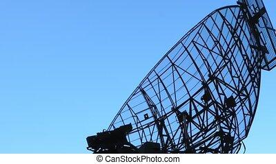 Rotating radar antenna air defense. Military mobile...
