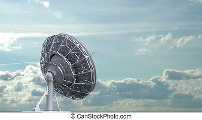 rotating radio telescope on sky background, 3d animation