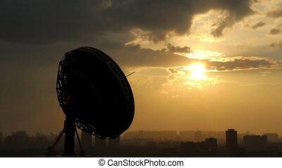 rotating radio telescope at sunset, 3d animation against sky background