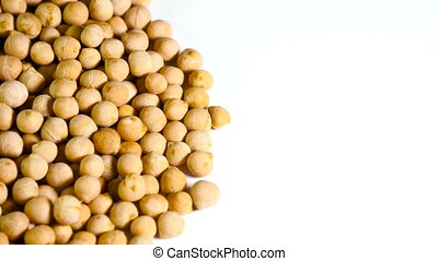 Rotating raw chickpea beans, vegan healthy nutrition.