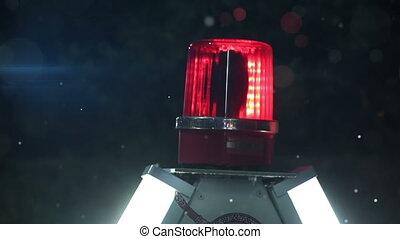 rotating red siren light