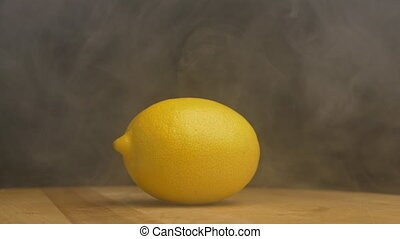 Rotating ripe lemon from which breathes cool and freshness,...