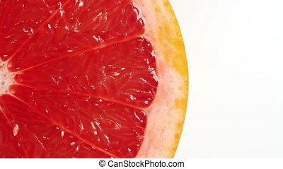 rotating slice of grapefruit (seamless loopable) isolated on...