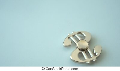 Rotating spinner in the form of a dollar. Spinner rotates...