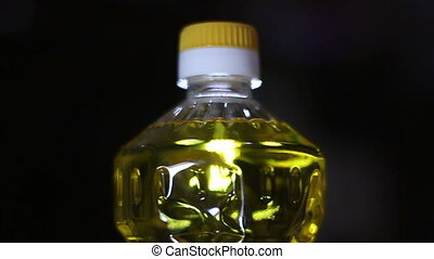 Rotating sunflower oil bottle. Looping continuous video -...