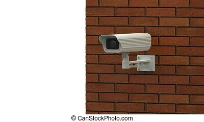 Rotating surveillance camera on brick wall