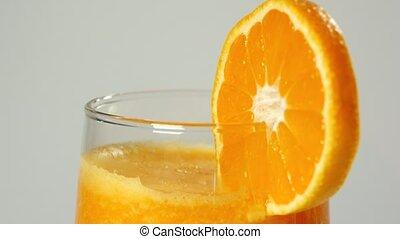 Rotating tangerine juice on the turntable (seamless...