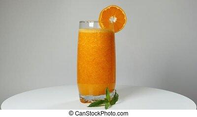 Rotating tangerine juice on the turntable