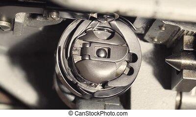Rotating the bobbin at the sewing machine - Extreme close up...