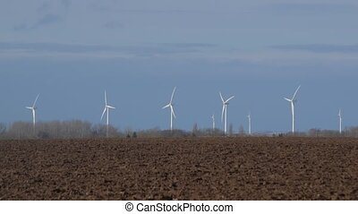 Rotating turbine towers on windmill field. Clean and...
