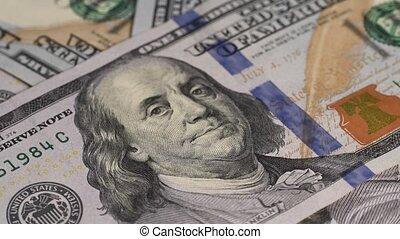 rotating US dollars - US dollars seamless loop, rotating...