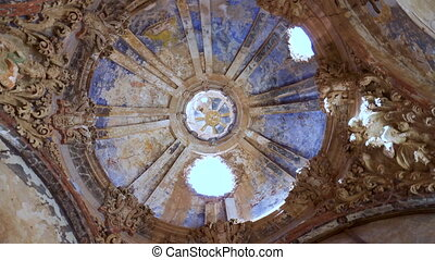 Rotating view of ceiling ruins of a destroyed church in the...