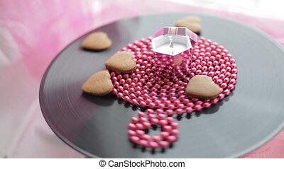 Rotating wedding ring in pink box