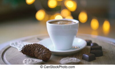 Rotating wooden background with coffee, candies and biscuit...